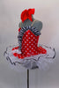 Red & white polka dot tutu dress has white tutu base with black sequin edge. Has black & white striped ruffle across sweetheart bodice. Comes with hair bow.  Left side