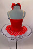Red & white polka dot tutu dress has white tutu base with black sequin edge. Has black & white striped ruffle across sweetheart bodice. Comes with hair bow. Back