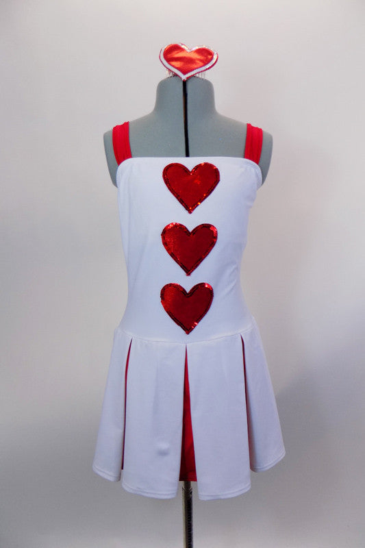 White leotard dress had attached red brief, pleated red & white skirt & wide red shoulder straps. There are 3 red hearts on the front & heart shaped hair comb. Front