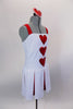 White leotard dress had attached red brief, pleated red & white skirt & wide red shoulder straps. There are 3 red hearts on the front & heart shaped hair comb. Side