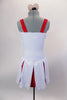 White leotard dress had attached red brief, pleated red & white skirt & wide red shoulder straps. There are 3 red hearts on the front & heart shaped hair comb. Back
