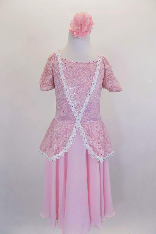 Pale rose chiffon dress has lace bodice with peplum & off shoulder, pouf lace sleeves. Bodice has white braided lace edge & is covered with pale pink crystals. Comes with pink floral hair accessory. Front