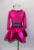 Black leotard has black sheer mesh midriff & black bottom. Has pink glitter skirt &  ¾ sleeved attached jacket style top has pink glitter heart on black bust. Comes with hair accessory. Back