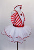 Red & white striped dress has pouf sleeves & white center edged in red sequin with large red cross applique. The attached skirt has petticoat with sequin edge. Comes with nurse hat accessory and ruffled socks. Side