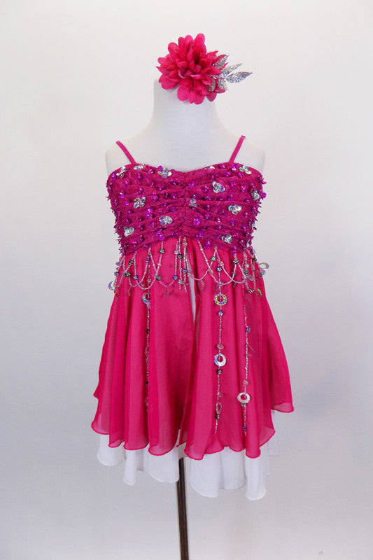 Fuchsia & white chiffon dress has empire waist. Laced pinch-front bust is adorned with hand sewn silver & pink sequins & floral beads dangle along the bustline. Comes with hair accessory. Front
