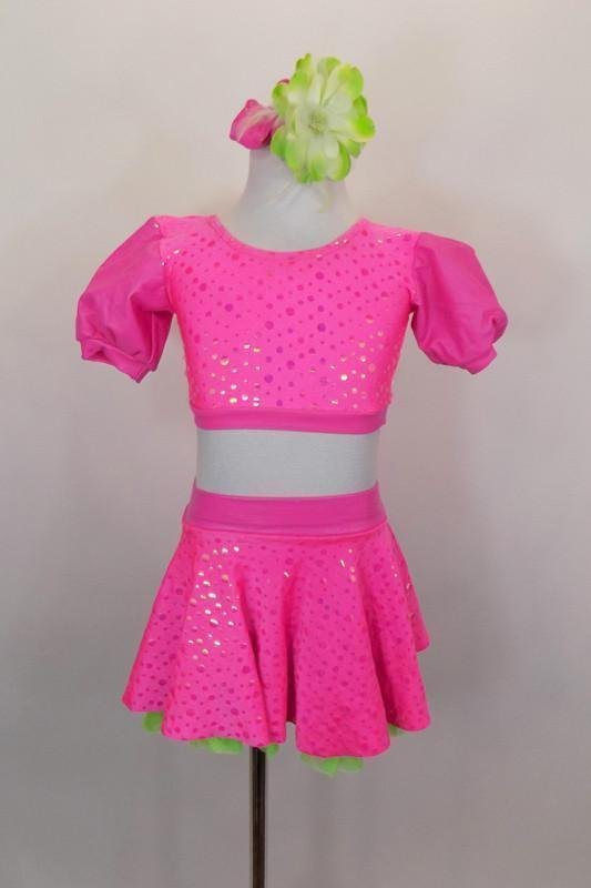 3-piece costume has neon pink bubble print skirt with green ruffled petticoat & attached panty. Tops include a green pleather bra below pouf sleeved half top. Comes with hair  accessory. Front