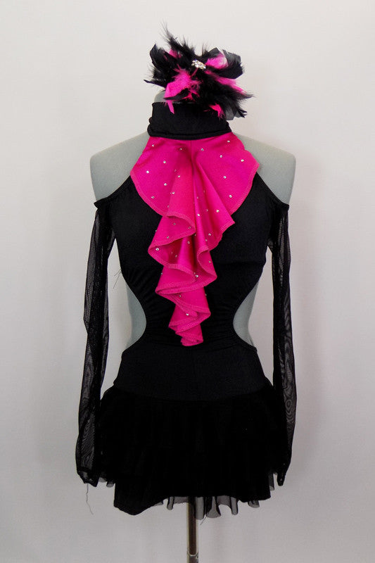 Black high collar halter leotard has bootie shorts, open sides & off shoulder mesh sleeves. There is an attached ruffled black mesh skirt & pink ruffled ascot. Comes with matching hair accessory. Front