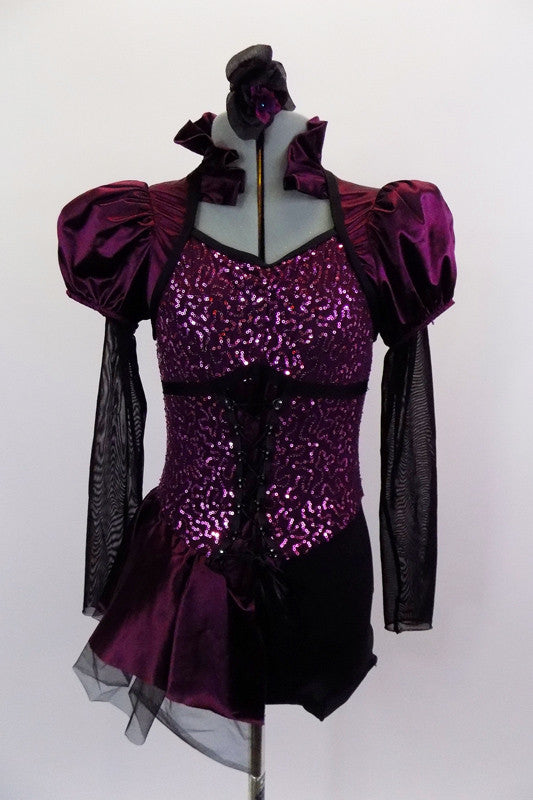 Corset style costume has purple sateen and black mesh pouf sleeves. Neckline is a Queen Anne style with ruffled neck & keyhole back. Has attached side bustle. Front