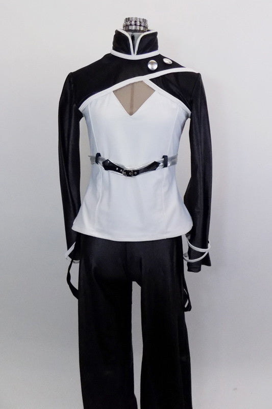 Black & white 2-piece costume has black pants with tie string at bottom & hanging suspenders with silver buttons. Jacket has mandarin collar & silver buttons. Front