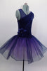 Navy tutu  has asymmetrical sequined bodice. Navy tulle, sits on layers of pale mauve tulle. Wide waistband gathers with a large navy flower on the right hip. Comes with hair accessory. Side