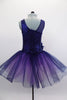 Navy tutu  has asymmetrical sequined bodice. Navy tulle, sits on layers of pale mauve tulle. Wide waistband gathers with a large navy flower on the right hip. Comes with hair accessory. Back