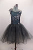 Romantic tutu dress in shades of grey has charcoal crystal tulle over layers of pale grey. The bodice is a charcoal, princess cut styles with embroidered lace. Comes with floral hair accessory. Front