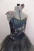 Romantic tutu dress in shades of grey has charcoal crystal tulle over layers of pale grey. The bodice is a charcoal, princess cut styles with embroidered lace. Comes with floral hair accessory. Front zoomed