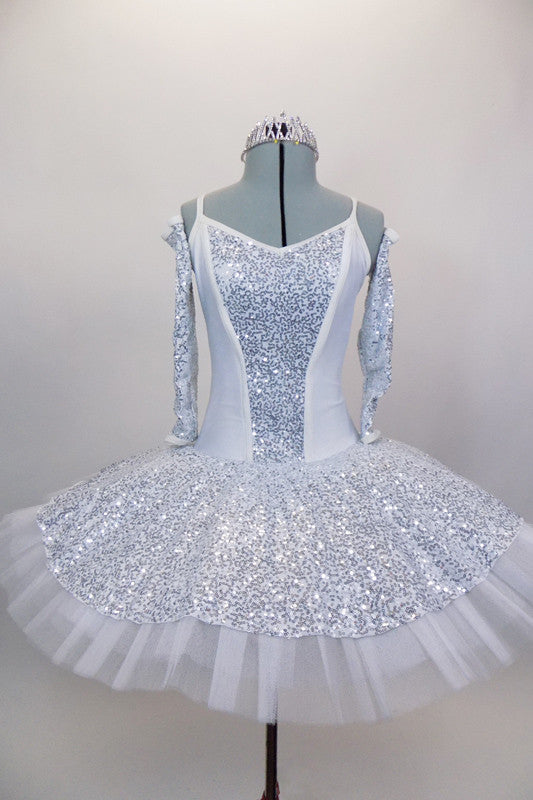 White platter tutu has silver sequined center on white bodice. Has matching silver sequined overlay over white professional tutu. Comes with gauntlets & tiara. Front