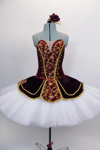 Burgundy red velvet sweetheart Russian style, 5 panel bodice comes with 10 layer pleated professional tutu with matching overlay, gold braid & lace accents. Comes with hair accessory. Front