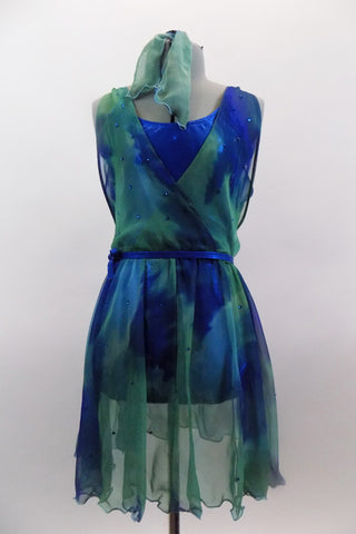 Chiffon cross-over dress in shades of blues & greens is covered with crystals & sits over top of an electric blue leotard with matching belt and hair accessory. Front