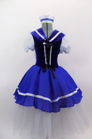Blue & white sailor themed romantic ballet dress has white pouf sleeves & velvet bodice with lace-up  front. Blue skirt overlay & collar have white ribbon edge over layers of white tulle. Comes with matching sailor hat. Front