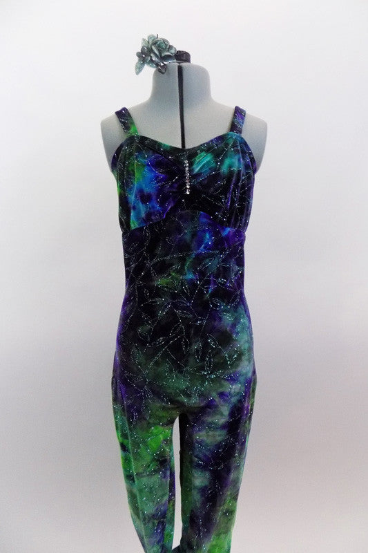 Stretch velvet full unitard with waves of purples greens & blues has silver pattern throughout. Has crystal accents at front & on bow accent of low back. Comes with hair accessory. Front