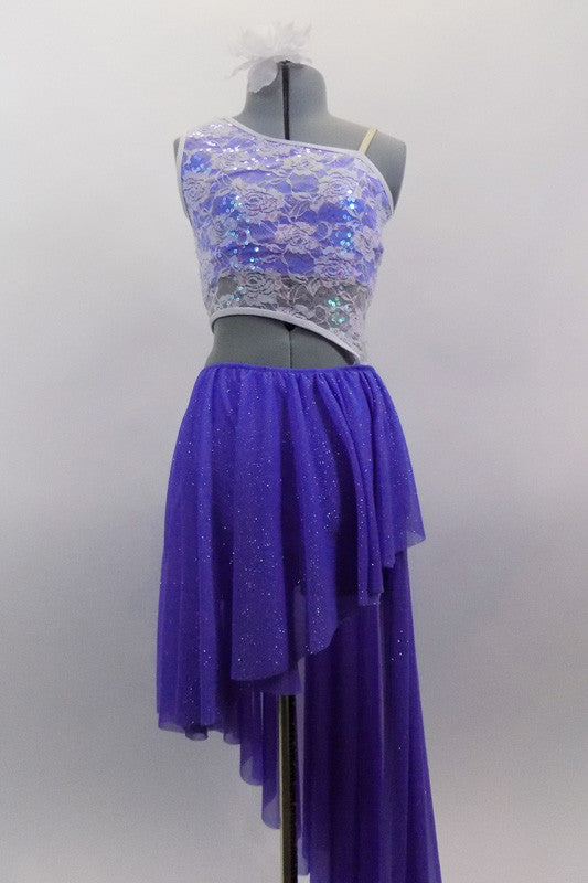 Periwinkle, glitter mesh asymmetrical skirt  is angled short at front & long at back. Skirt is attached to a white, asymmetrical sequined lace top at left hip. Comes with hair accessory. Front