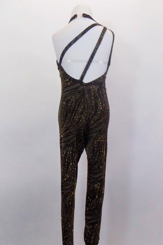 Unitard with stirrup bottoms has wave designs of grey silver & gold on black. Asymmetrical neckline & low back has double straps from right shoulder. Back