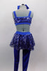 Royal blue unitard has fully sequined bodice with open back, sides & sequin peplum skirt. Has blue bow accent at the of torso & blue legging bottoms. Comes with large hair bow. Back