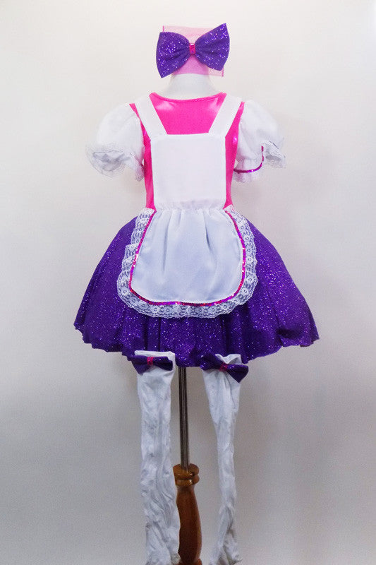 Bright pink bodice with large white pouf sleeves & layered, purple skirt. Has attached white pinafore apron with lace ruffle. Comes with stockings & hair bow. Front