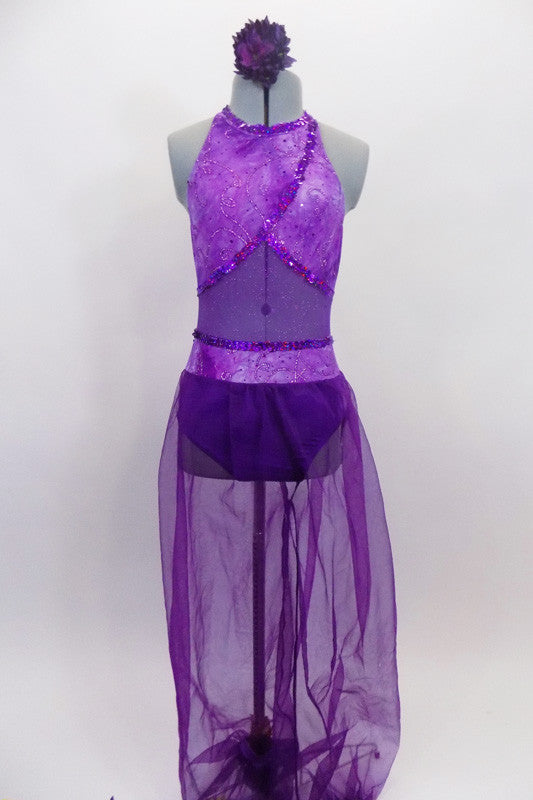 Purple Arabian themed 2-piece costume has halter style leotard with light purple, cross-over front, purple glitter mesh middle & dark purple bottom. Matching purple sheer harem pants have light purple waist. Comes with hair accessory. Front