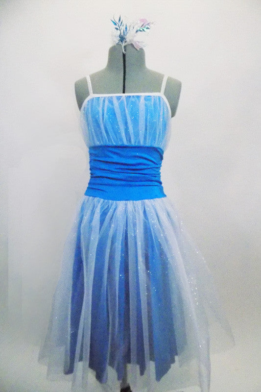 Turquoise dress has white crystal tulle overlay skirt & pleated bust. The wide turquoise waistband is ruched & gathered at sides. Has elastic glitter straps. Front