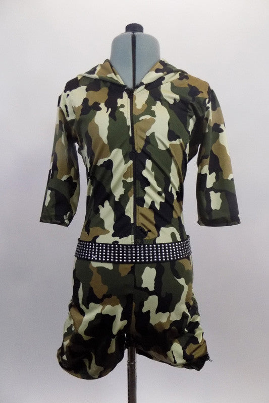 Army themed, camouflage, lined short unitard has front zipper & three quarter sleeves. It features an attached black studded belt & a hood collar. Front