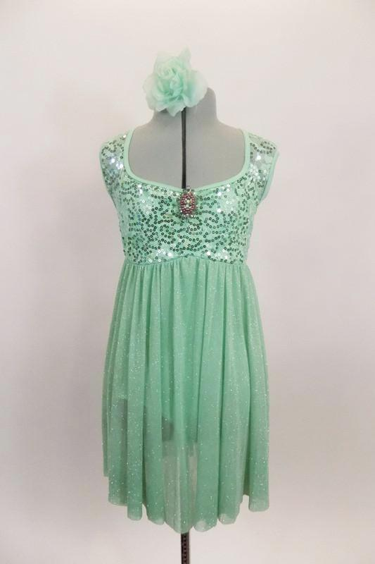 Mint leotard dress has sequined A-line bodice with brooch accent and open back. The skirt is a soft flowing glitter mesh. Comes with matching hair accessory. Front