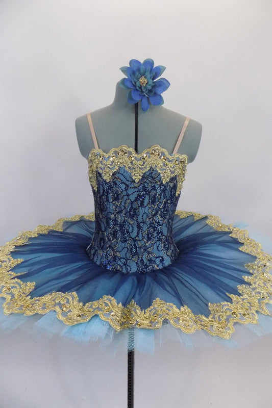 Deep blue tulle sits on light blue tulle layer & white pancake tutu base. Bodice is deep blue & gold lace lined with pale blue spandex. Has wide gold lace trim.. Front