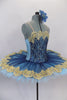 Deep blue tulle sits on light blue tulle layer & white pancake tutu base. Bodice is deep blue & gold lace lined with pale blue spandex. Has wide gold lace trim. Side