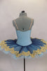 Deep blue tulle sits on light blue tulle layer & white pancake tutu base. Bodice is deep blue & gold lace lined with pale blue spandex. Has wide gold lace trim. Back