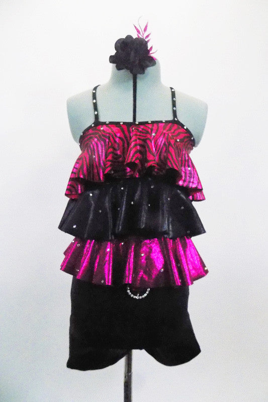 Black & fuchsia short unitard has 3-layered ruffled torso of pink/black zebra print,  black &  shiny fuchsia The ruffles and straps are covered with crystals to match belt buckle. Front