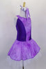 Lavender tutu dress has purple floral print skirt, front center & shoulders, with dark purple sides & back. There is a pleated white 3-layer tutu below skirt. Comes with matching hair accessory. Side
