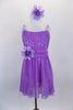 Lavender sequined sheer leotard dress has gathered front bodice with crystal accents Low open back has cross straps. Wide waistband gathers in bow knot at back. Has large flower at waist and matching hair accessory. Front