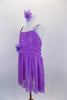 Lavender sequined sheer leotard dress has gathered front bodice with crystal accents Low open back has cross straps. Wide waistband gathers in bow knot at back. Has large flower at waist and matching hair accessory. Side