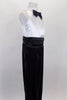 Black & white jumpsuit has white tank style upper with tuxedo shirt front, keyhole back & black bow tie accent. Black sequin pants have cummerbund waistband. Comes with black sequined hat. Right side