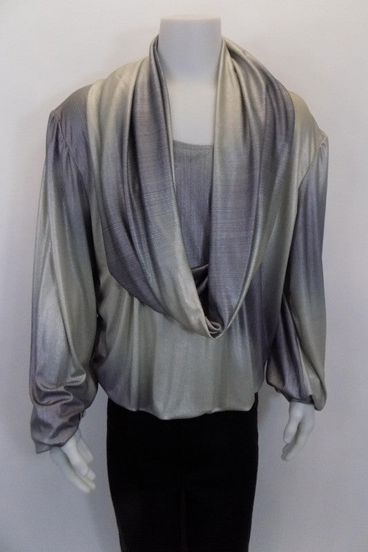 Peasant style men's Silver/grey leotard shirt has flowing sleeves,  and deep cascading cowl neck. The bottom has a series of three strong snap closures. Front