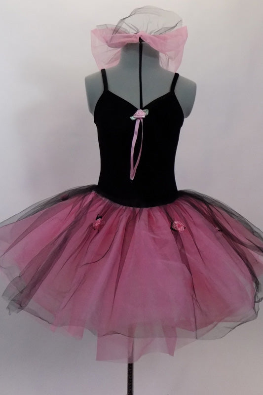 Black velvet camisole leotard dress with pink satin roses has an attached romantic tutu skirt in layers of pink nylon mesh with black tulle overlay. Comes with hair bun ruffle. Front