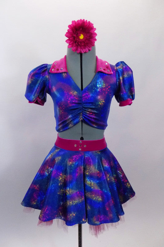 Blue base, 3-piece costume has pinks & golds throughout. Pouf sleeved half top has hot pink, crystalled velvet collar & matching skirt. Has pink floral hair accessory. Front