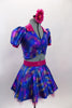 Blue base, 3-piece costume has pinks & golds throughout. Pouf sleeved half top has hot pink, crystalled velvet collar & matching skirt. Has pink floral hair accessory. Side