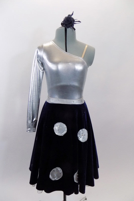 Silver metallic one shoulder long sleeve leotard is accompanied by navy blue velvet skirt with large crystalled silver buttons. Skirt has ruffled petticoat. Comes with hair accessory. Front