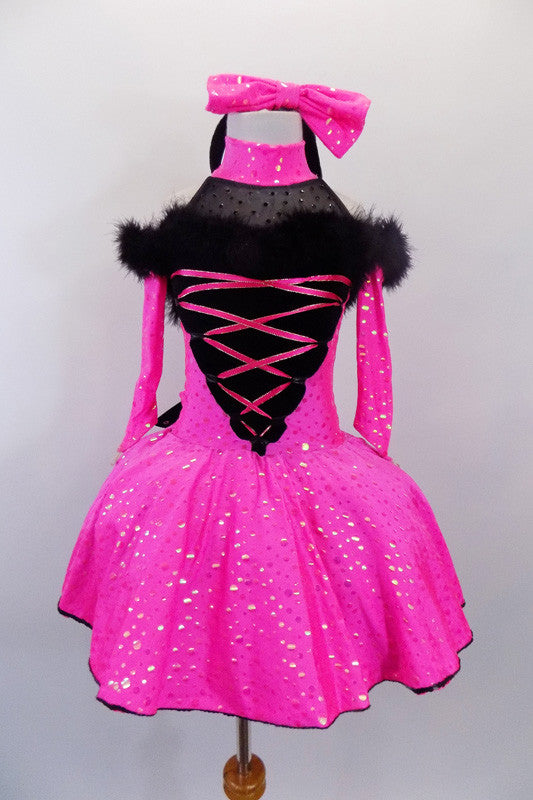 Pink & black halter-neck dress has crystal covered black mesh upper on pink dot dress with off-shoulder long sleeves. Black V front has pink lacing & black marabou fur trim. Comes with matching headband and large bow at back. Includes separate black velvet coat. Front without coat