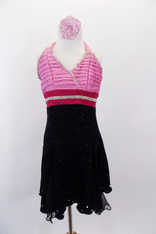 Halter A-line dress has light pink pleated cross-over front bodice & hot pink waistband both lined with crystals. Skirt is layers of black crystal sheer. Comes with matching hair accessory. Front