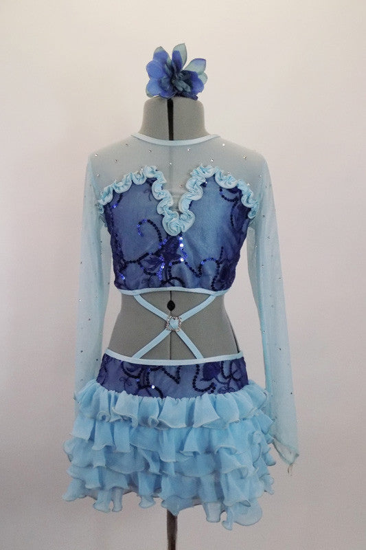 Pale blue long sleeved mesh half-top scattered with crystals, has ruffled bust area with dark blue sequin lace overlay. It is attached to ruffled chiffon skirt. Comes with blue floral hair accessory. Front