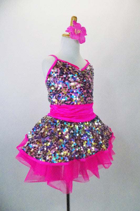Sparkly camisole dress in rainbow sequins sit on a hot pink tutu skirt, with pink straps & cummerbund waist. Comes with matching pink jacket & hair accessory. Right side view no jacket
