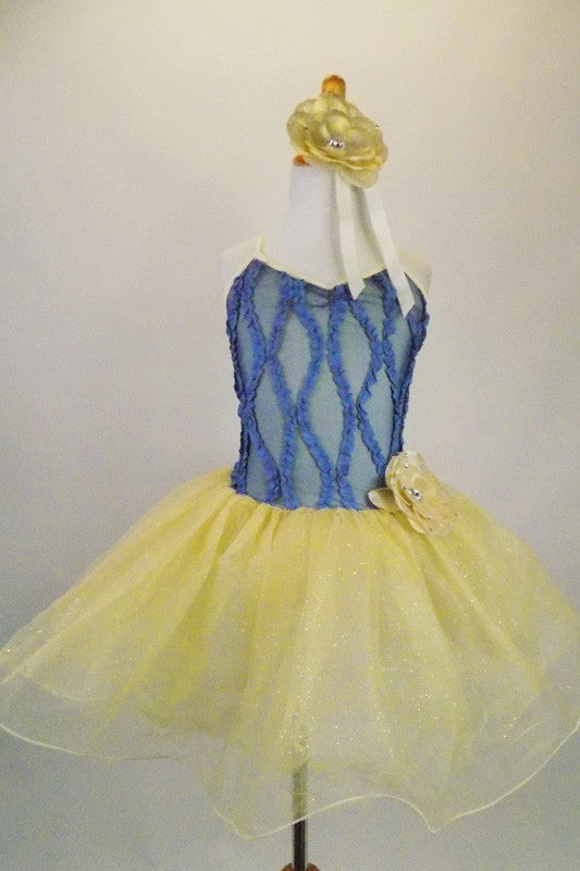 Cornflower blue mesh bodice has gathered diamond pattern on gold base with attached gold glitter tulle skirt.  Comes with floral belt and hair accessory. Front