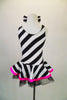 Sweet black and white striped tank dress with hot pink accent makes a statement. Has black tulle petticoat beneath the skirt. Comes with large black & white hair bow. and pink gauntlets. Back