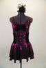 Fuchsia metallic camisole dress has full skirt with brief. Front is embellished with black velvet bow. Has black velvet corset belt & mini top-hat accessory. Front